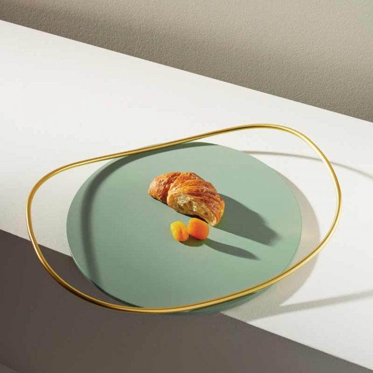 Photo of touché tray in sage green with croissant, design by Martina Bartoli for Mason Editions